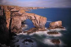 Green Bridge of Wales (JimCochrane) Tags: ocean longexposure sea cliff motion landscape islands coast movement rocks waves arch swell pembrokeshire greenbridgeofwales nd10