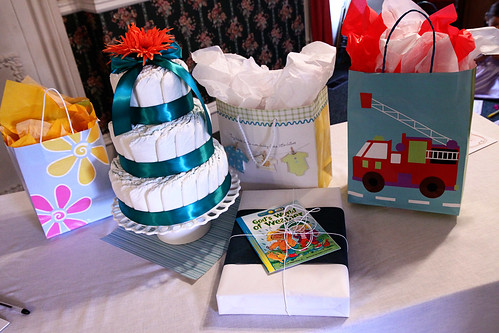 . diaper cake and gift table .