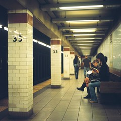 Reading (Inside_man) Tags: people newyork reflection 120 6x6 tlr film colors rolleiflex mediumformat subway reading bokeh manhattan platform citylife fluorescent 33rdst portravc