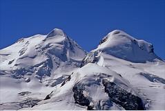 zwillinges (Ron Layters) Tags: mountain snow geotagged switzerland twins pentax slide glacier velvia transparency zermatt fujichrome wallis castor valais pollux icefall pentaxmz10 mountainsalps elevation40004500m mattertal ronlayters 4226m slidefilmthenscanned 4092m monterosamassif zwillinges summitcastor altitude4226m summitpollux altitude4092m geo:lon=7857285 geo:lat=45988971