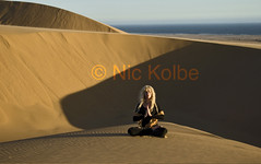 Desert Yoga (NamWizard) Tags: sea woman yoga interesting desert dunes beautifulwoman meditation namibia atlanticocean asana namaste lotusposture yogapose soulscapes theunforgettablepictures 100commentgroup sigik