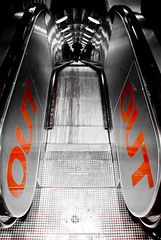 OUT (tristanlb) Tags: light red brussels portrait bw white man black colour reflection art metal out belgium belgique pentax escalator perspective deep bruxelles reflet reflect da absolutely exit soe selective blueribbonwinner abigfave k200d perrrfect tristanlb