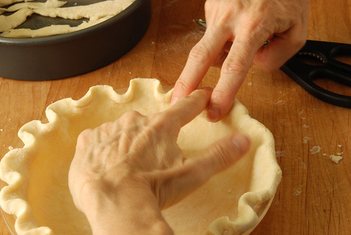 Putting ruffle edge on pie crust with my fingers.
