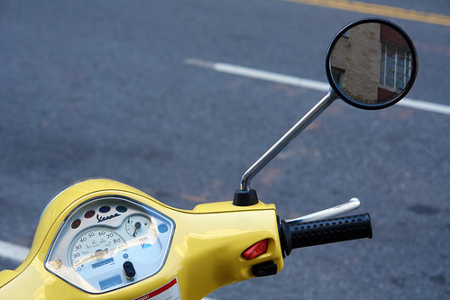 yellow vespa and mirror