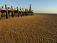 Ripples in the sand (Tony Worrall) Tags: old uk blue england sky brown color texture beach lines sex metal grit outdoors golden wooden seaside sand nw pattern colours view northwest steel postcard sandy columns victorian scenic rusty structure dirty lancashire splinter shore ripples poles rotten damaged upright seashore hue crusty built abandonned relic olden wavey supports strands lancs fylde stannespier stannesonsea