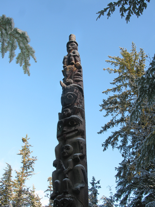 morning light and snow on a totem pole, Kasaan, Alaska