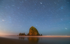 Star Storm over Haystack Rock (Darren White Photography) Tags: longexposure beach nikon explore oregoncoast frontpage startrails nighttimephotography darrenwhite darrenwhitephotography
