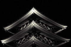 pointing upwards (jonathan vdk) Tags: wood light blackandwhite black japan night triangles dark point religious temple 50mm tokyo pagoda wooden pointy religion culture symmetrical asakusa sharpedges canon50d