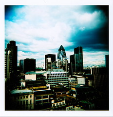 Bankers (Matt Brown esq) Tags: city reflection building london film monument glass skyline mediumformat square office holga lomo xpro lomography view bank slide swissre gerkin banking stmarysaxe bankers