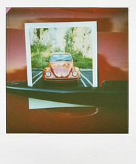 red beetle (mosippy) Tags: red vw bug volkswagen polaroid sx70 losangeles beetle pictureofapicture 600film sunsetplaza