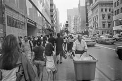 Heading Upstream (28 Dreams) Tags: nyc newyorkcity blackandwhite ny newyork streetphotography 5thavenue diafine leicam6 trix400