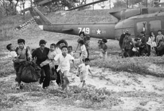 Refugees from the Central Highlands run for rescue helicopters to evacuate them to safety (manhhai) Tags: people war asia southeastasia aircraft battle vietnam vehicle grassland survival assistance southvietnam historicevent asianhistoricalevent northamericanhistoricalevent unitedstateshistoricalevent vietnamwar19591975 vietnamesehistoricalevent