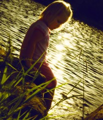 Little Girl at the River (Ekler) Tags: park sunset summer lake art nature water girl weather rock river season photography photo shiny warm poem sitting shine expression daughter dream picture calming peaceful happiness pic calm dreaming blond littlegirl dreamy gras sparkly annamaria effect orton artisitic mountainpark ekler oldschooldigital sprkle olympuse410 soloha