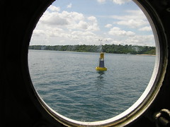 A research buoy near Atwater Beach, as seen through a porthole aboard the Neeskay. ~photo Jennifer Yauck