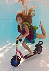scooter dance (david_CD) Tags: girls summer kids swim children fun crazy underwater dress dive bubbles scooter roller losangles subm lightonkids pixel2canvas