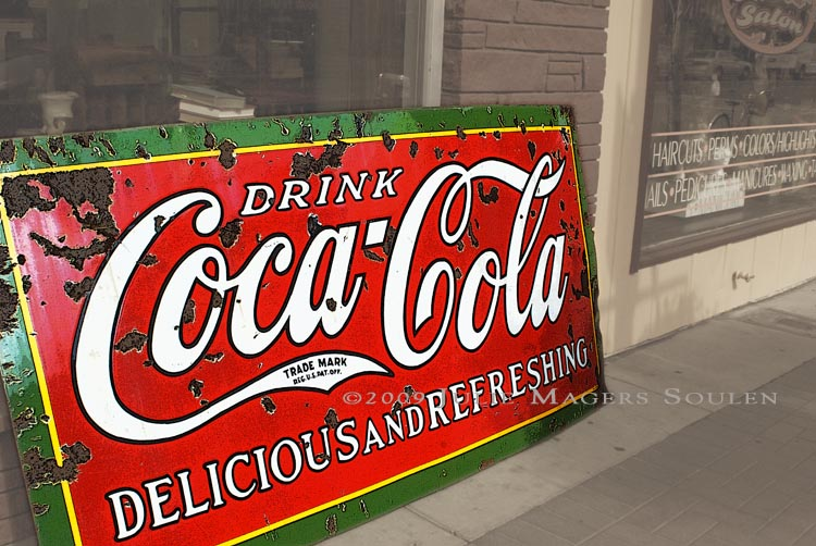 antique Coca Cola sign with a patina of age
