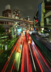 Zipping Through Tokyo (Stuck in Customs) Tags: world life road street city travel light urban motion black blur color cars rain japan night speed buildings dark concrete photography tokyo high nikon october energy asia long exposure cityscape traffic dynamic stuck district culture overpass special trail nightlife expressway top100 streaks range 2009 hdr wards trey minato rappongi blacktop customs zipping ratcliff stuckincustoms d3x