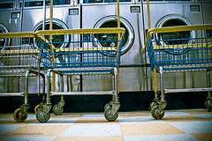 baskets and washers (ryan myers captures) Tags: county street blue yellow floors photoshop canon georgia tile real eos rebel ryan athens clean wash laundry baskets service bettys laundromat carts clarke detergent dryers myers captures lightroom casters oglethorpe xti laundrohmat