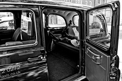 For Hire? (Chris JL) Tags: door uk blackandwhite bw london car bench relax reading photo break candid cab taxi streetphotography solo driver rest exit forhire warmweather spnp nikkor2470mmf28g e2m nikond3s
