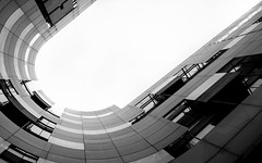 Broadcasting in Black & White (DobingDesign) Tags: maccormacjamiesonprichard architecture bbc london blackandwhite abstract broadcastinghouse modernarchitecture glass translucentfaçade worldpiazza convex shape curve arc lookingup abstractarchitecture