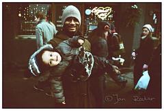 snapshot of father and son (jrockar) Tags: street portrait london kid xprocess child kodak crossprocess father son 1600 chrome madness elite 400 push pushed process ordinary decisive kodakelitechrome400 ordinarymadness