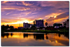 a golden sunset (Soumya Bandyopadhyay) Tags: sunset sky lake reflection water colors buildings golden day saltlake end kolkata offices gradnd aplusphoto sector5 pentaxk200d pentax1855mmii