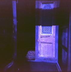 knocking on the unknown door (QsySue) Tags: door shadow mediumformat open toycamera slidefilm 120film doorway hollywood vignetting expiredfilm holga120n cahuengablvd reallyoldfilm kodakektachrome64professional titleisawaterboyslyric dwwg like30yearsold