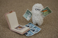 I am stamp collector Treeson. (thesinisterpenguin) Tags: baby white cute bird nerd birds digital fun toy toys happy glasses book other crazy nikon geek blind box stamps label awesome bubi au vinyl mini cutie stamp hong kong collection explore series dslr stories collector yeung crazylabel d40 treeson explored samgreen bubiauyeung thesinisterpenguin