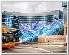 Waves of glass in Warsaw - ZloteTarasy (I come back to my dear metropolitan corners) (in eva vae) Tags: street blue building bus glass modern clouds waves poland warsaw 1001nights hdr polonia varsavia tonemapping abigfave theunforgettablepictures platinumheartaward sailsevenseas