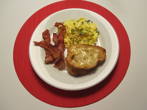 Scrambled eggs with chives, bacon, toast