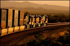 Chasing The Setting Sun in Arizona (greenthumb_38) Tags: 2005 railroad sunset trains bnsf westbound goldenhour glint goingaway intermodal warbonnet stacktrain glintshot mixedpower desertrailroading jeffreybass bnsftranscom