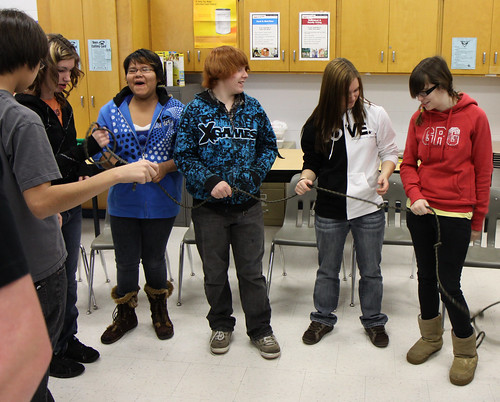 Grade 9 students trying to Untie the Knot at todays Character Education workshop.