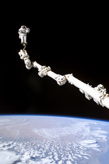 Astronaut Atop Canadarm-2 (Review of U.S. Human Space Flight Plans Committee) Tags: station eva space stephen nasa international robinson iss sts114 canadarm2