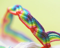 rainbow tubes (*glow) Tags: macro wool colors yellow canon eos rainbow colorful glow friendship handmade craft 100mm yarn bracelet usm 80 wristband f28 threads friendshipbracelet nouf 450d