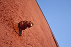 Clogged Faucet (Tailer Ransom) Tags: blue cambridge sunset red summer abstract color broken pool architecture composition canon hearts geotagged eos rebel big aperture nikon flickr bricks group competition 7d faucet walls 1855mm minimalism simple gypsy tailor sanfransisco ransom xsi williamscollege ruleofthirds vandalized canonrebels lockwood bitchesbrew clogged tailer bareminimum 450d canoneosrebelxsi ministract winksplace maxiministract tailerransom tailorransom canoneoss