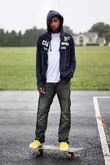 Devon. (Jesse_Jacobs) Tags: boy portrait man guy rain yellow jesse outside photography 50mm teen devon teenager vans skater jacobs f18 raining