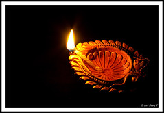 Happy Deepavali (kdinuraj) Tags: light india lightpainting lamp festival canon lights mirror flickr indian prayer celebration oil diwali 2009 inhome deepawali deepavali inhouse oillamp springbeauty canon50mm18 wic indianfestival 400d canon400d mudlamp inhomeshot