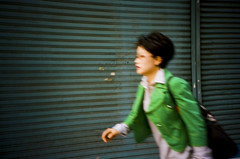 Hurried (codooaustin) Tags: door camera portrait woman film girl face lady 35mm dark walking person glasses blurry lomo lca lomography gate asia fuji body superia south capital korea iso business seoul shutter 100 asa lc russian 35 reala compact automat corners a