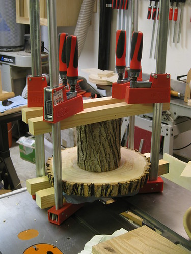 gluing together the parts of the log cake stand