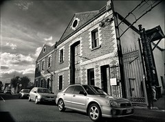 fitzroy gothic #5 (mugley) Tags: city sky urban blackandwhite bw building brick cars 120 film architecture clouds rollei mediumformat 645 fitzroy grain perspective australia melbourne wideangle victoria vehicles negative epson parked polarizer 6x45 streetscape r3 mamiya645 urbanlandscape redfilter polariser 25a id11 v700 cloudage keystoning mamiya645protl ilfotec m645 rolleir3 envelopments 35mmf35sekorn 10springst