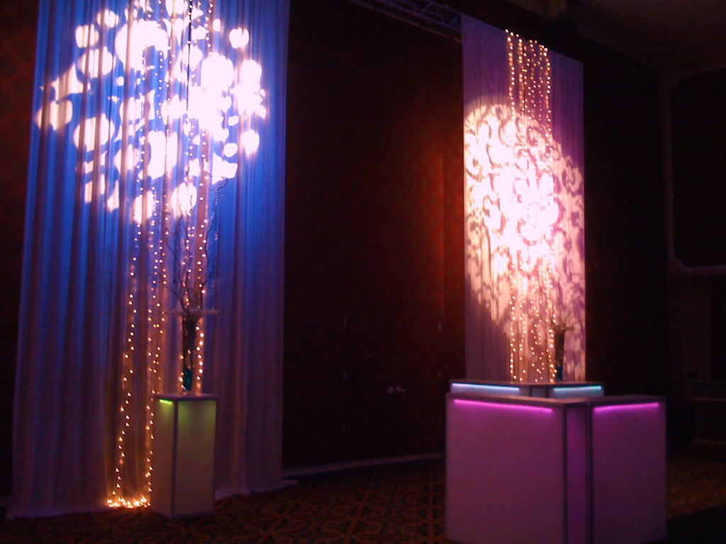 glowing bars with gobo patterns on white drape
