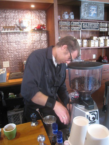 Elvin makes coffee at Olympia Coffee Co