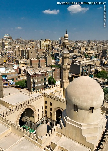 The more modern mosque next door dominates the foreground of this view of old Cairo from the top of the spiral minaret at Ibn Tulun.