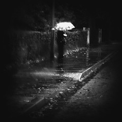 White Umbrella. (r i c k . m) Tags: autumn blackandwhite bus wet rain umbrella waiting solitude miserable solitary damp notextures hourofthesoul