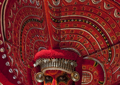 Man Dressed For Theyyam Ritual With Traditional Painting On His Face, Thalassery, India (Eric Lafforgue) Tags: india worship vishnu kerala indie ritual hindu indi indien hind indi inde headdress hodu headwear headgear indland  hindistan devam indija   ndia hindustan kannur kasargod teyyam  theyam 2715    hindia  theyyattam bhrat  kolathunadu indhiya bhratavarsha bhratadesha bharatadeshamu bhrrowtbaurshow  hndkastan