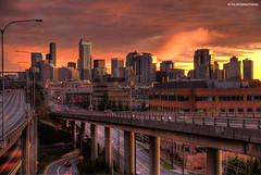 Autumn Sunset in Seattle (TIA International Photography) Tags: seattle city autumn sunset urban sunlight cars skyline buildings tia concrete daylight washington high highway shiny downtown december cityscape glare shine dynamic metro cloudy dusk overpass overcast pacificnorthwest metropolis pugetsound interstate autos roads elevation avenue washingtonstate citycenter range exchange emeraldcity citycentre hdr highdynamicrange height closure interstate5 glisten fredhutchinson lakeviewboulevard eastlakeavenue skyrscrapers tosinarasi tiascapes tiainternationalphotography