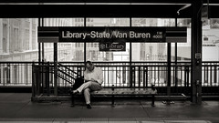 Library-State/Van Buren (jakebouma) Tags: city blackandwhite bw chicago sign businessman train bench subway illinois waiting downtown sitting cta candid widescreen library seat theel trainstation signage vanburen subwaystation 169 brownline trainstop thel chicagotransitauthority windycity abigfave librarystate