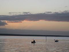 Girls kayaking in sunset