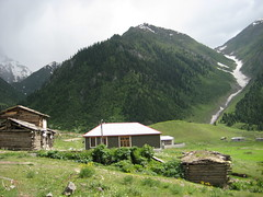 Minimarg, Pakistan. (Four@Wanderers) Tags: wood trip travel flowers houses pakistan house mountain snow mountains water beautiful beauty field wooden high cool scenery stream village jeep plateau smoke traditional pass mini scene wanderers kkh info kashmir areas peaks northern marg plain 2009 height sar natco excursion jimny unmatched resthouse nanga parbat deosai nangaparbat astore sheosar ramavalley sheo domel treshing minimarg 4wanderers domail trishing ramarest burzil minimurg minmurg burdil burzill