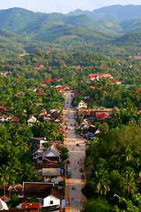 Birds eye view of Luang Prabang  Laos (kees straver (will be back online soon friends)) Tags: street travel mountains statue river children landscape temple boat asia southeastasia buddha buddhist monk buddhism laos wat lao mekong luangprabang meekong keesstraver